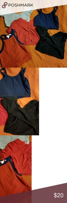 Bundle of 5 bandeau/cropped undershirts Gray, red, black and navy blue bandeau/cropped undershirts.. I wore them under my overalls, low cut shirts, see through shirts, etc. The gray and black ones criss-cross in the back.. gently worn with no stains or tears. If you only want one shirt just message me and let me and let me know which one and make me an offer and we'll make something happen Forever 21 Intimates & Sleepwear Bandeaus
