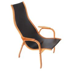 Modernist 1960s Yngve Ekstrom Leather and Birch Lounge Chair | From a unique collection of antique and modern lounge chairs at https://www.1stdibs.com/furniture/seating/lounge-chairs/