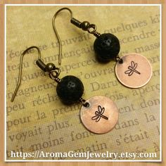 Length: 1.75 inch Antiqued gold brass disc: 12 mm black Lava stone: 8 mm  These beautiful earrings are hand stamped creating an adorable