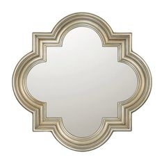 Quatrefoil-shaped wall mirror with a grooved frame and champagne finish.    Product: Wall mirror  Construction Material...