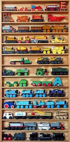 train storage...best idea ever for our ever growing collection of Thomas the train toys! They all normally just thrown in a bin....this way they can be put up and enjoyed then they aren't cruising the tracks!! For kane's room, above pir train table.