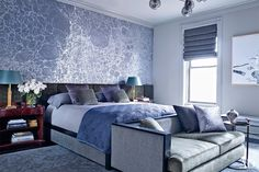 In the Harlem home of Neil Patrick Harris and David Burtka, a wall covering by Calico Wallpaper adds intrigue to the suavely decorated master bedroom
