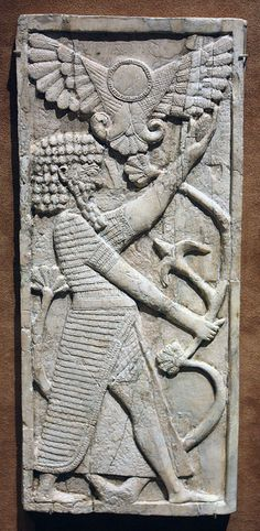 Panel with a male figure grasping a tree; winged sun disc above. Neo-Assyrian, ca. 8th century B.C.  Mesopotamia, Nimrud (ancient Kalhu)