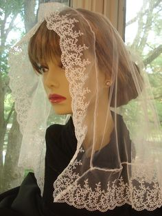 A White Half Circle Veil/ Tulle and Embroidered Netting Mantilla/ Catholic Headcovering For Holy Mass. The Breda Veil.. $26.95, via Etsy.