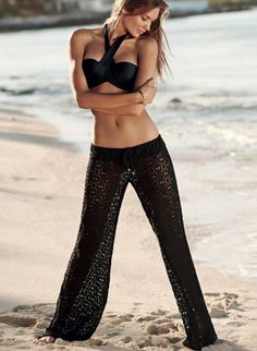 Low rise eyelet lace pants from Pily Q feature a wide leg, relaxed fit and drawstring waist by Pily Q Swimwear, $124.00