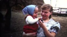(8mm Vintage) 1952 Iowa Mother Introducing Baby To Chicken Hatchling. http://www.pond5.com/stock-footage/51409531?ref=StockFilm keywords:1952, chicken, hatchling, mother, baby, daughter, mothers day, chick, iowa, farm, 8mm, footage, film, home video, home movie, homemade, retro, vintage, classic, old, reel to reel, 16mm, projector, super 8, amateur, grainy, archive, nostalgia, memories, restore, preserve, romance, cinematography, golden age, Americana, political, advertisement, history…