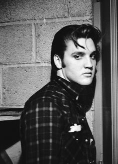 Elvis backstage between shows in Dayton, Ohio, May 27, 1956. Photo by Marvin Israel.