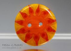 Love the colours in theis one - handmade lampwork button by Helen G http://www.etsy.com/shop/helengbeads