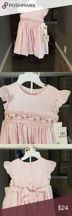 NWT  Laura Ashley 12 M dress with bloomers Brand new never been worn beautiful pink and white seersucker dress by Laura Ashley. Ruffle sleeves with bow that ties in the back. It comes with a slip lining and matching bloomers. Perfect for a pretty little girl! Laura Ashley Dresses Casual
