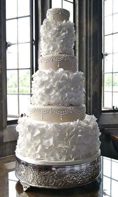 Something like this, but just the two middle layers. Beautiful Cake Pictures: Pretty White Ruffles & Pearls Wedding Cake : Cakes with Pearls, Cakes With Ruffles, Wedding Cakes Beautiful Wedding Cakes, Gorgeous Cakes, Pretty Cakes, Dream Wedding, Yacht Wedding, Wedding Reception, Wedding Cake Pearls, Cake Wedding, Luxury Wedding Cake