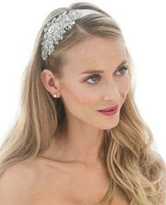 This beautiful ribbon headband boasts a casted rhodium floral side motif accented with gorgeous pave crystals, and proves to be an elegant alternative to a traditional #bridal headpiece. David's Bridal Style H7593: http://bit.ly/HqRWev