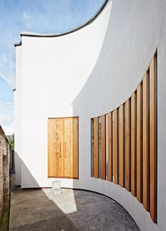 Curves have been scooped out of the sides of this house for a pianist in Exeter, England