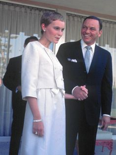 Frank Sinatra and Mia Farrow  Frank Sinatra and his wife, actress Mia Farrow, are shown during a news conference at the Sands Hotel in Las Vegas, Nevada, July 19, 1966.  http://www.chicagotribune.com/entertainment/music/sinatra-farrow-1966-jpg-20150123-photo.html