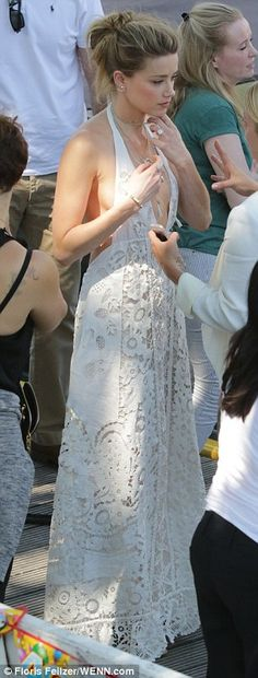 Daring: She teamed the cream, lace dress with several necklaces which only accentuated her never-ending neckline