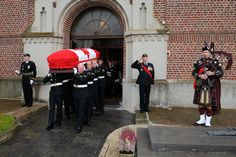 The Bearer Party consisting of Canadian Forces soldiers from the Princess Patricia Canadian Light Infantry carries First World War soldier Private (Pte) Alexander Johnston out of Église Saint-Aubert in Sailly-lez-Cambrai, France.  Pte Johnston a member of the 78th Battalion of the Winnipeg Grenadiers, died in battle on September 1918.  Photo by Corporal Dianne Neuman, CFSU(O) Photo Services © 2011 DND-MDN, CANADA