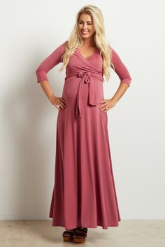Next time you're looking for the perfect date night look, search no further. This draped maternity maxi dress has you covered. A flattering style and solid, versatile design like this will have you looking and feeling beautiful as the night goes on. Great not only for you expecting mothers, but easily transitions into motherhood with a draped v-neckline, perfect for nursing.