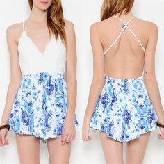 """Fleurette"" Lace Backless Floral Romper Lace front blue floral romper with a cross back. Great quality, fully lined. Only available in this color. Brand new. Junior sizing. NO TRADES. PRICE FIRM Bare Anthology Pants Jumpsuits & Rompers"