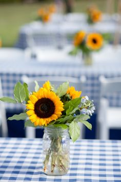 Sunflower Centerpiece for rehearsal dinner, but with lemons in the jar too!