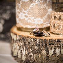 Rustic centerpieces, Mason jars, wood stumb, wedding rings