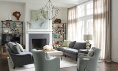 Atlanta Transitional Home - Nandina Home & Design living room with two sofas in a neutral color palette and etagere