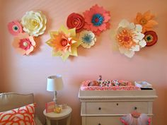 DIY Paper Flowers - these make such an impact on this nursery wall! Love the pop of color and texture.