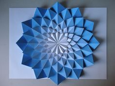Kota Hiratsuka is a Japanese paper engineer that has been exploring origami by manipulating paper into these beautiful geometrical formed mosaics. He also has them for sale on his site Origami Mosaics, be sure to check them out! Origami Rose, Diy Origami, Origami And Kirigami, Origami Stars, Origami Flowers, Paper Flowers, Oragami, Blue Flowers, Dollar Origami