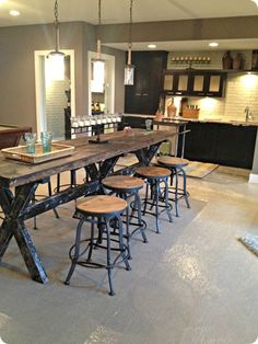LOVE the table and it would be a pretty easy DIY. But those bar stools, I couldn't love them more!!