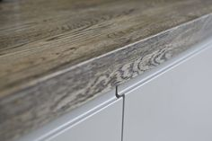 Integrated Handleless Matt Lacquer kitchen with aged Oak worktops. Oak Worktops, Handleless Kitchen, Hardwood Floors, Flooring, Furniture Design, Interiors, Contemporary, Wood Floor Tiles, Wood Flooring