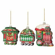 "3 Christmas train-themed blown glass ornaments in a festive palette.  Product: 3 OrnamentsConstruction Material: GlassColor: MultiDimensions: 3"" H each"