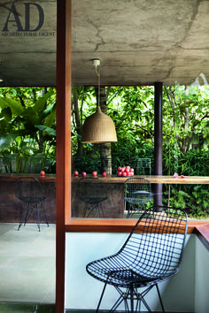 The #outdoor #dining area in the #Bengaluru home of #architect Sandeep Khosla and his wife Tania Singh Khosla, a #graphic #designer. #Eames wire #chair, @IKEAUSA #pendant #light. Photographer: Tom Parker