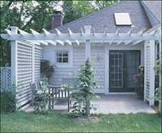 Attached Pergola - To create a semi-private, outdoor seating area close to home, this Pergola extends from the house side with attached lattice panels.