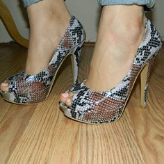 "Lilac Purple snake print platform peeptoe heels 7 Snake print. Lilac purple color and black. About 1.5"" platform. New. They have just been stored in closet. I used to live in a garden unit when i got these and i think they got a little humidity in them.. see last pic* will need edges to be re-glued... NEVER BEEN WORN.. Need new home Shoes Heels"