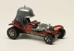 Hotwheels - Red Barron.  I should have saved it, worth about $3000.00 now...ouch.