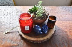 Pretty things, grouped together. This is one of our fail-safe styling tips. We love to collect candles, succulents and other pretty things on a tray or lazy Susan or even a beautiful piece of wood like this centerpiece from Naseem's dining table.