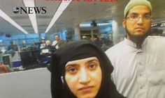 The moment America clutched a killer to its breast: Terrorist wife pictured as she presented herself at immigration in the country she hated - 16 months before she and husband gunned down 14 in San Bernardino, California. (7 December 2015)
