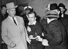 Jack Ruby shoots Lee Harvey Oswald November 24, 1963 -  the sniper who assassinated John F. Kennedy