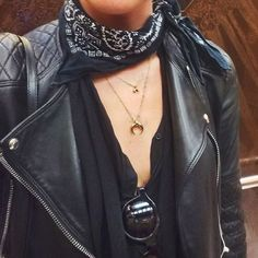 Leather jacket, bandana, golden necklaces.