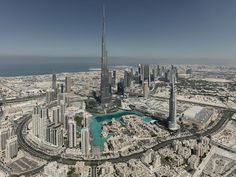 Standing at feet, the Burj Khalifa is the tallest artificial structure in the world. Along with that record, the Burj holds over 15 other distinct records. For Sale Sign, Sale Signs, Paris Skyline, New York Skyline, Burj Khalifa, Awesome, Amazing, The Past, Engineering
