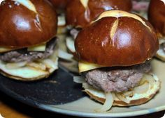 Miniaturizing burgers means being able to have more than one! Sliders are one of my favorite parts of summer and it gets even better when you include fun things like pretzel rolls and gourmet cheese varieties.