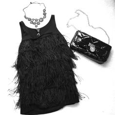 ANN TAYLOR feather tank Classy tank top with tiers of black feathers . Great for cocktail party or evening wear by Ann Taylor NEW! Never worn/excellent condition. (necklace & handbag not included) Ann Taylor Tops Tank Tops