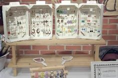 How do you get your jewelry noticed at craft fairs without drowning in the ocean of competition? The answer is unique displays that draw the eye. Here are some examples.