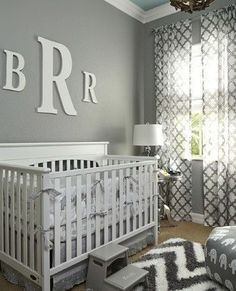A variety of gray tones—slate, charcoal, silver—come together for a relaxing, monochromatic space. Pops of white balance the grays and keep this gender-neutral nursery feeling just right.
