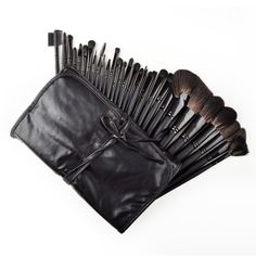 Megashopping 32 Pcs Black Rod Makeup Brush Cosmetic Set Kit. Roll up carrying case stores and protects brushes with ease. The most organized and elegant way to carry your make up and cosmetics. Eco-Friendly. high quality makeup case designed for professional use. 32 Piece brush set in a beautiful pouch. Brushes are made of quality natural hair and synthetic fiber for lasting performance.