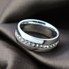 Beautiful Stainless Steel Eternity Wedding Band with One row of clear Cubic Zirconia (approx. wide band Our new durable 316 Stainless Steel is becomin Titanium Wedding Rings, Titanium Rings, Wedding Ring Bands, Wedding Finger, Engagement Bands, Engagement Jewelry, Wedding Jewelry, Stainless Steel Wedding Bands, Mens Stainless Steel Rings