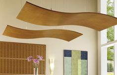 Add interest to your stores ceiling with products such as these Armstrong Woodworks S-curve canopies.