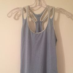 Nike DRI-FIT Workout Top Nike DRI-FIT women's workout top, size S.  In excellent condition!  More of a light blue/grey color Nike Tops Tank Tops