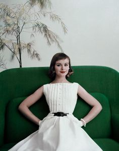 White cotton pique dress by Teena Paige, patent leather belt by Elegant, gloves by Superb and pearl earrings and bracelet by Marvella, 1956