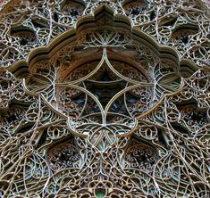 nspired by Gothic and Islamic architecture artist Eric Standley constructs intricate stained glass windows from numerous sheets of laser cut paper.
