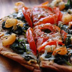 Spinach and shrimp flatbread with tomato, pecorino, and rosemary - could also use naan for the base