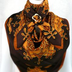 For that opulent, luxurious Look that will keep you warm this winter, use 1 Anneau de Luxe Horn Scarf Ring with 2 Vince HERMES Scarves from Carre de Paris